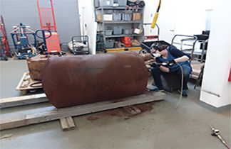 Conservators Lifting Cannon