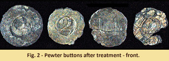 Military buttons after treatment.