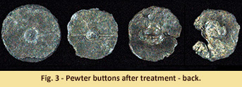 Military buttons after treatment - back view.