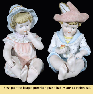 "These painted bisque porcelain piano babies are 11"" tall."