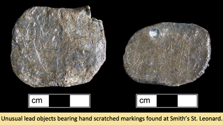 Unusual lead objects bearing hand scratches from Smith St. Leonard Site.