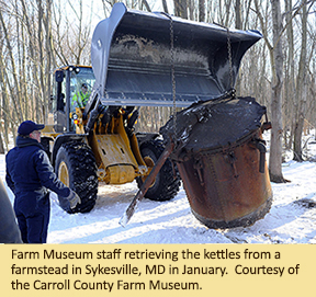 Farm Museum staff retrieving the kettles from a farmstead in Sykesville, MD in January.