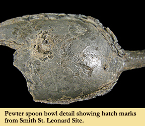 A pewter spoon found at Smith's St. Leonard Site with hatch marks visible on inside of spoon bowl.